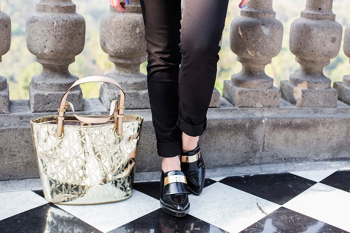 Golden bag and statement black shoes